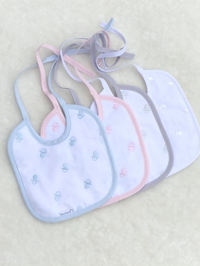 spanish baby bibs with dummy motif
